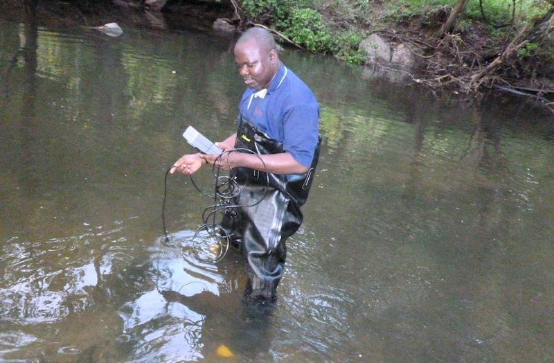 Akinleye measures in-stream water quality as part of a program that was established in 2010 to offer an interdisciplinary, advanced degree for those interested in water sector jobs. Photo courtesy of Deksissa.
