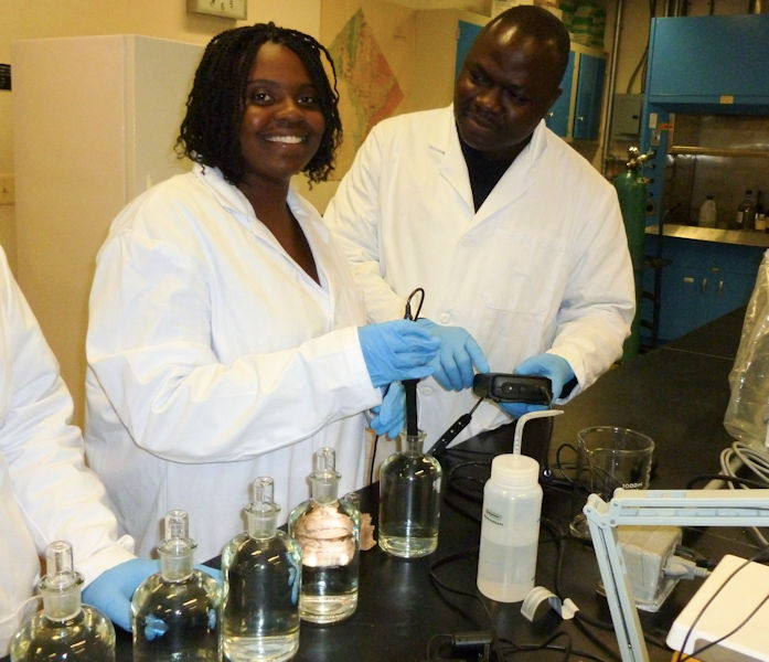 From left, Metea Wright and Olushola Akinleye have graduated from the program which combines lessons in laboratory science, research, communication, and entrepreneurship. Photo courtesy of Deksissa.