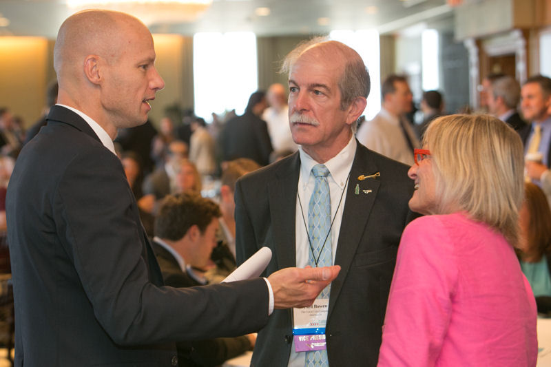 From right, Ralston and Paul Bowen, another past president of WEF, talk with the Chicago Water Summit 2014 luncheon keynote speaker, Henk Ovink, senior advisor to the secretary of U.S. Department of Housing and Urban Development. Photo courtesy of Kieffer Photography.