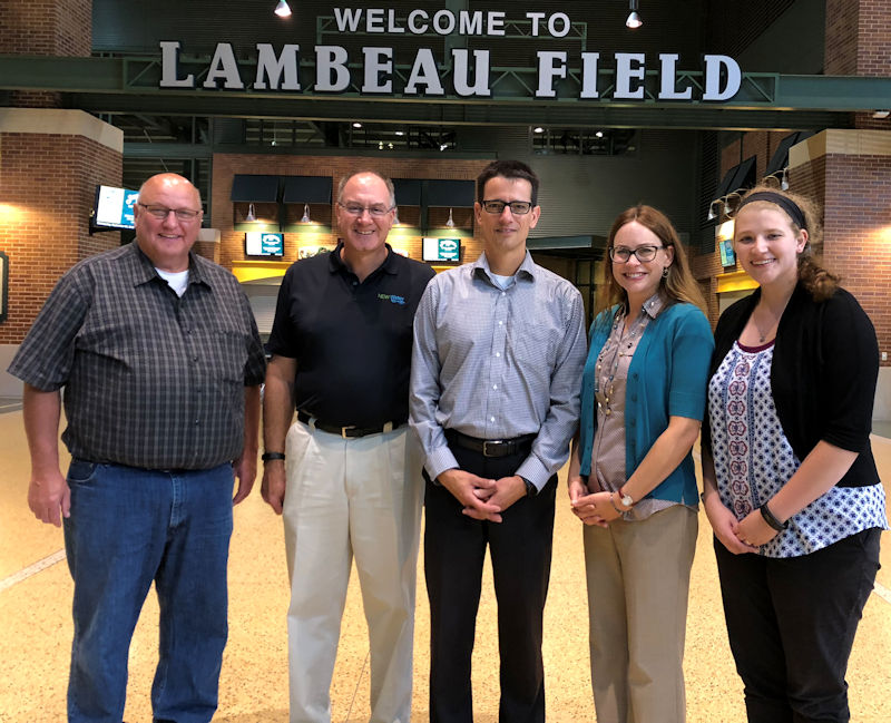 Sigmund (second from left) tours Lambeau Field and discussed watershed issues from representatives of the Green Bay Packers football team. Photo courtesy of Garrison.
