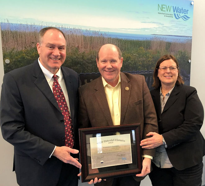From left, Sigmund presents U.S. Congressman Reid Ribble (R–Wis.) with a NEW Watershed Champion award alongside Green Bay Water Utility General Manager Nancy Quirk during the 2016 World Water Day celebration. Photo courtesy of Garrison.