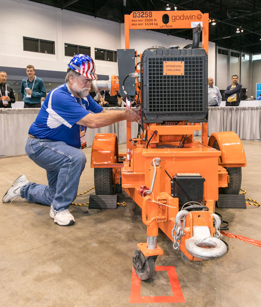 "At WEFTEC 2017, James ""Jim"" E. Miller poses to recreate a similar image of Miller from the first Operations Challenge competition in 1988. Photo courtesy of Kieffer Photography."