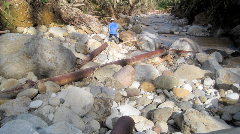 An old water distribution pipe that was damaged during Hurricane Maria lies on a river bed in Dominica. Photo courtesy of Marcel Misuraca, Ontario Clean Water Agency.