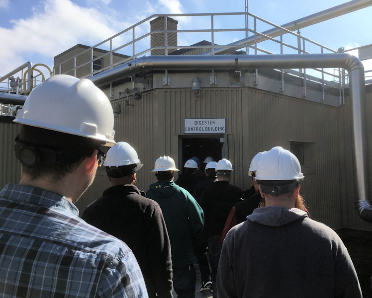 Program participants enter a digester control building at the Narragansett Bay Commission Bucklin Point wastewater treatment facility to get hands-on education and ideas for how to improve processes at their own facilities. Photo courtesy of RIDEM.