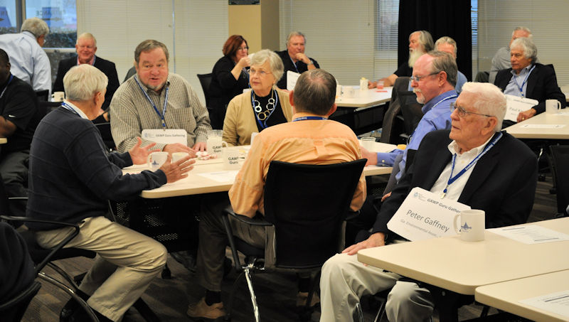 Attendees at During a Guru Gathering, attendees outfitted with extra-large name tags learn about what the association and others in the committee are doing. Photo courtesy of the Georgia Association of Water Professionals.
