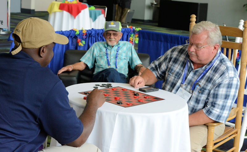 Members of the Georgia Association of Water Professionals Guru committee play a checkers on the Guru porch during an annual conference. Photo courtesy of Donald Douglas Photography.