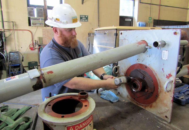 Zach Hulstine, a HRSD apprentice, rebuilds a secondary clarifier sump pump. Photo courtesy of HRSD.