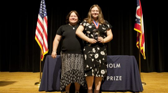 Sonja Michaluk (right), backed by her mother (left), receives the 2019 U.S. SJWP during the national competition, held June 13 to 16 at the Ohio State University (Columbus). Photo courtesy of Annelise Taggart.