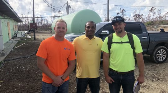 Todd Saums (left) and Tom McGrain (right), water professionals working for the Northwestern Water and Sewer District (Bowling Green, Ohio), recently volunteered with Operators Without Borders to help restore water and wastewater services in the hurricane-battered Bahamas. Photo courtesy of Saums.